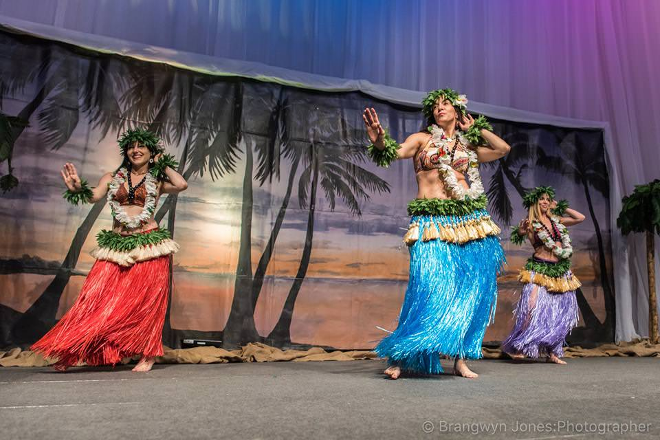 We can hear the Hawaiian Guitars playing...